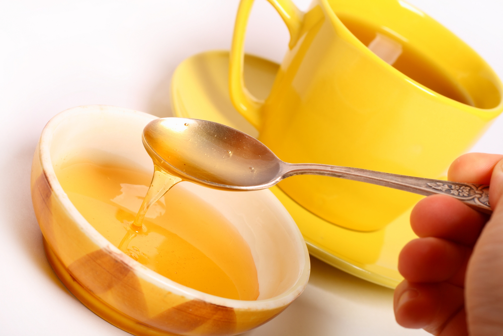 yellow tea cup and honey